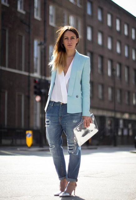 With blouse and distressed jeans