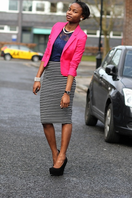 With lace blouse, striped knee-length skirt and black shoes