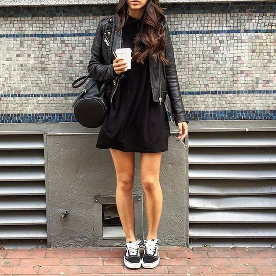 total black look with a mini dress, a leather jacket and Vans