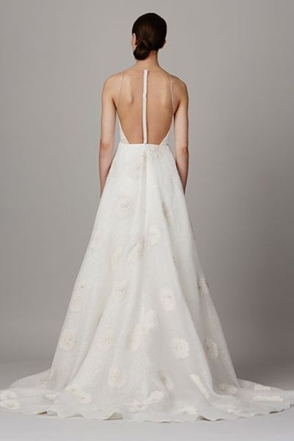 modern wedding gown with lace appliques and an illusion racerback