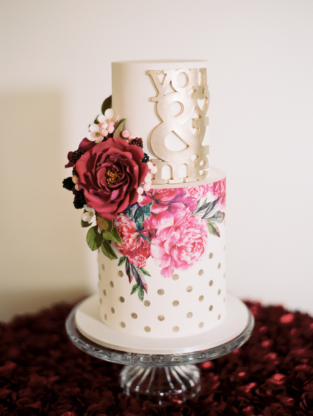 Valentines Day wedding cake with polka dots and flowers - photo by Erin Stubblefield http://ruffledblog.com/chic-city-valentines-day-wedding-inspiration