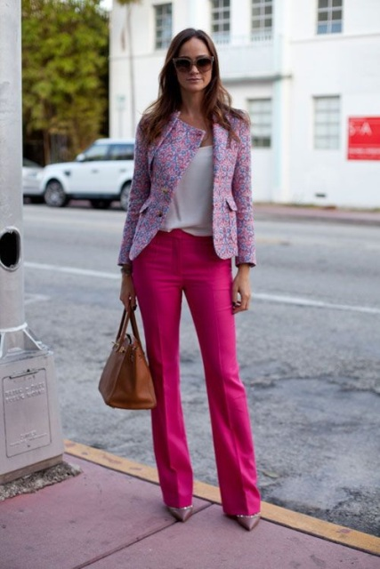 With white top, pastel color jacket, brown bag and neutral color shoes