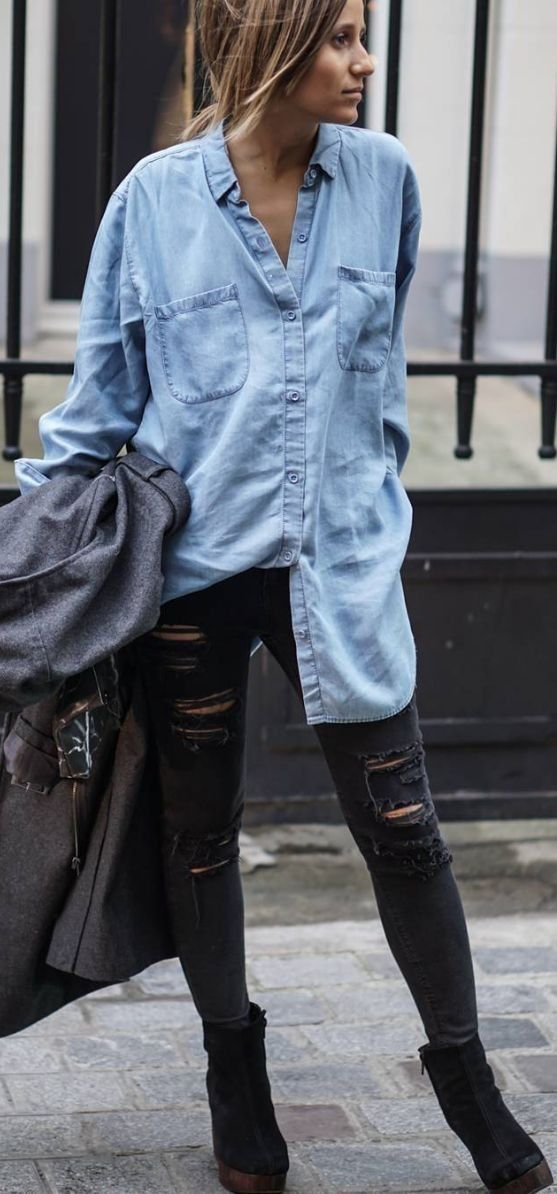 black ripped jeans, a chambray shirt and boots