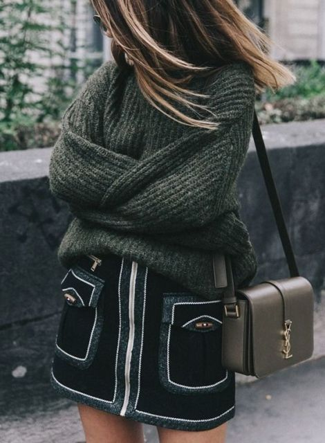 With cozy sweater and mini bag