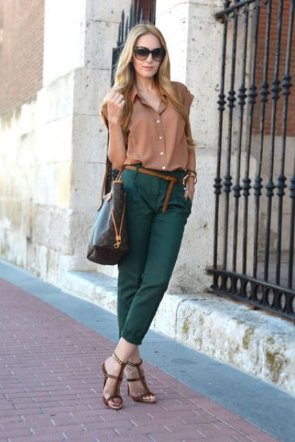 With neutral color shirt, belt, heels and tote