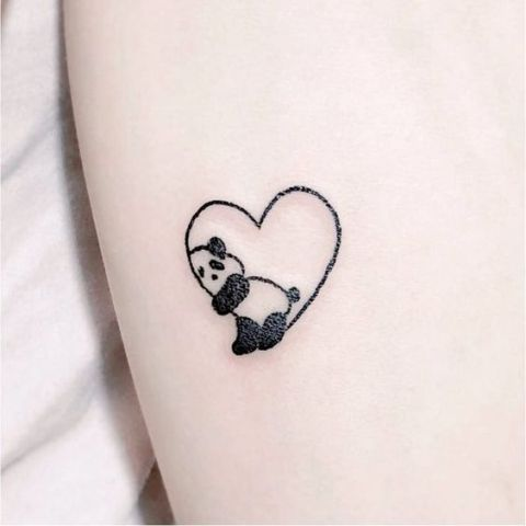 Panda with heart tattoo
