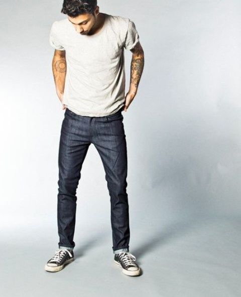 navy jeans, black Converse and a light-colored tee