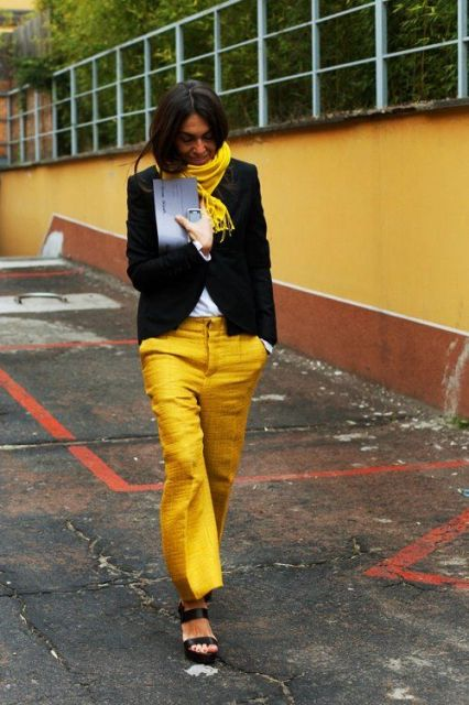 With white shirt, black jacket, yellow scarf and platform shoes