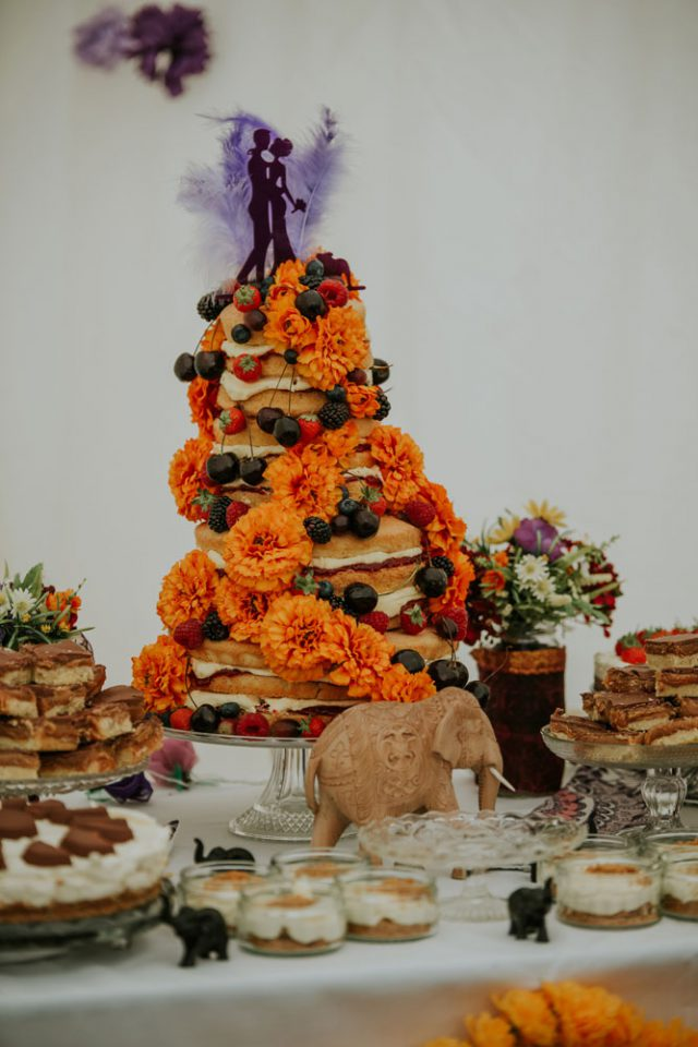The wedding cake was a bold naked one, with orange flowers, cherries and strawberries