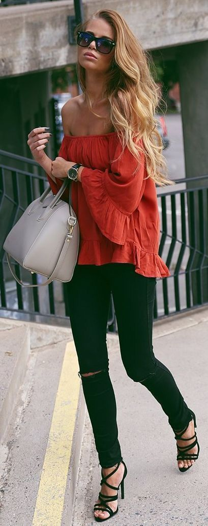black ripped jeans, lace up heels and a red off the shoulder top