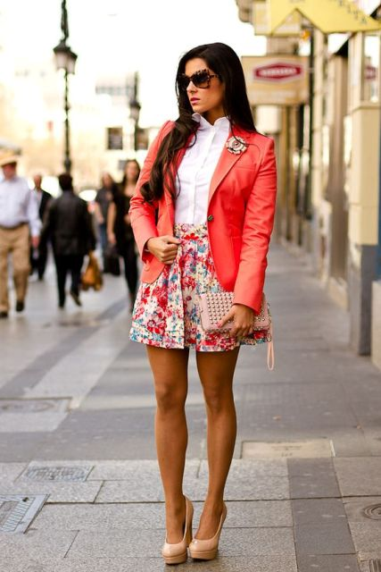 With white shirt, floral mini skirt and beige shoes