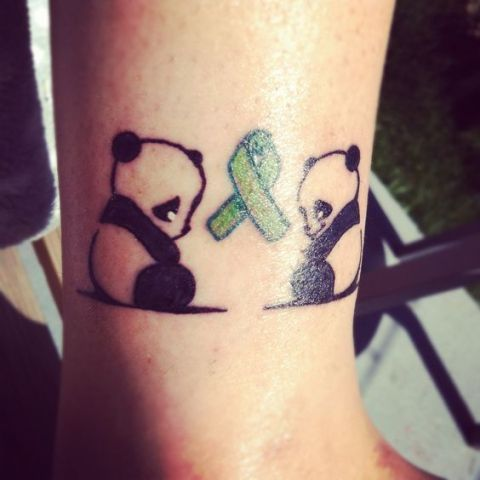 Two panda bears tattoo on the ankle