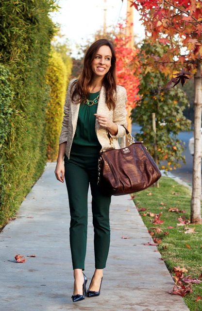 With green blouse, beige jacket, heels and necklace