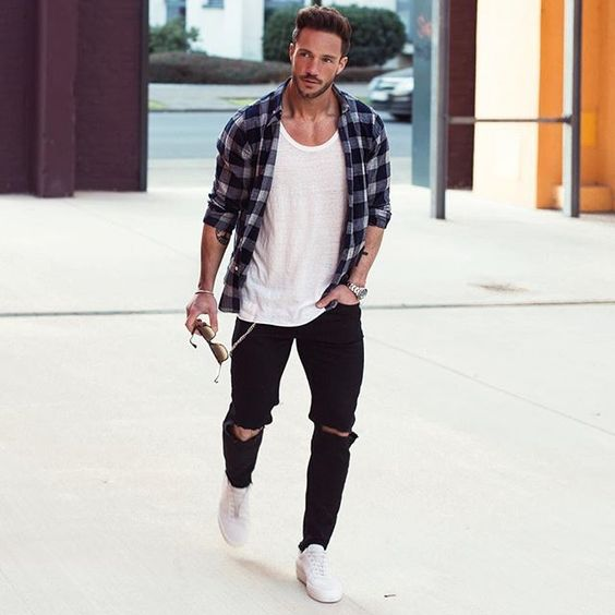 black ripped denim, a white tee, a plaid shirt and white sneakers