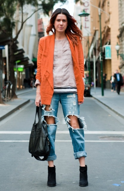 With sweatshirt, distressed jeans and ankle boots