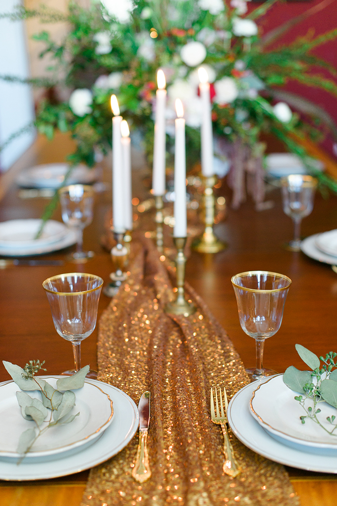 Gold tableware, gold rim glasses and some eucalyptus made the table setting more exquisite