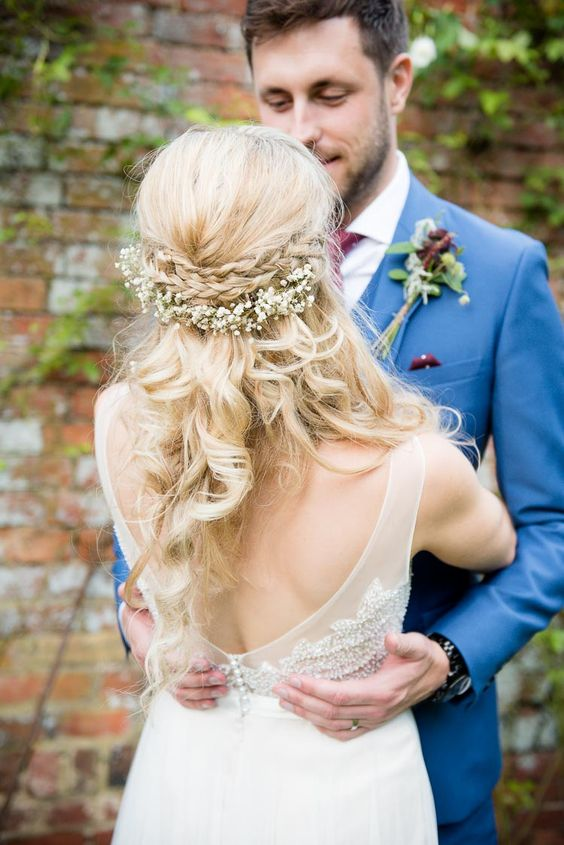 braided half updo with baby's breath looks sweet