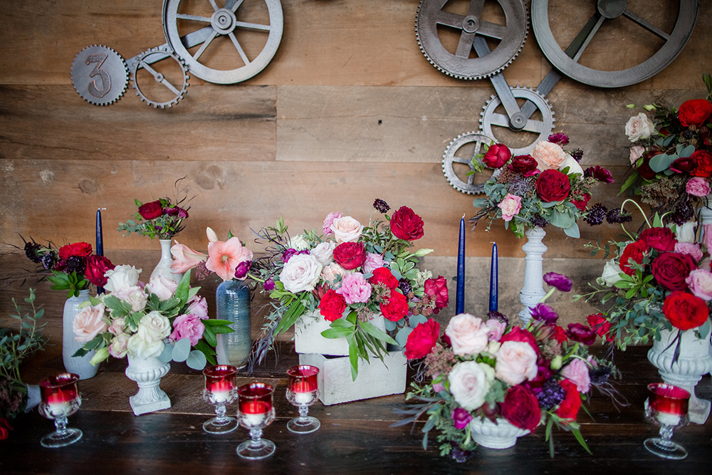 wedding flowers with red and pink - photo by Laura Wick Photography http://ruffledblog.com/elegant-parisian-inspired-wedding-ideas