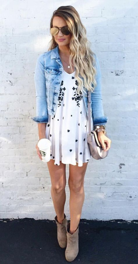 a printed mini dress, a distressed denim jacket and neutral suede boots