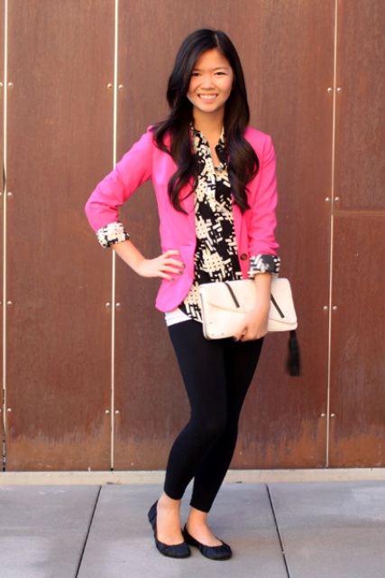 With printed shirt, black leggings, black flats and white clutch