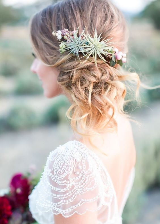 side swept updo with succulents and tiny flowers