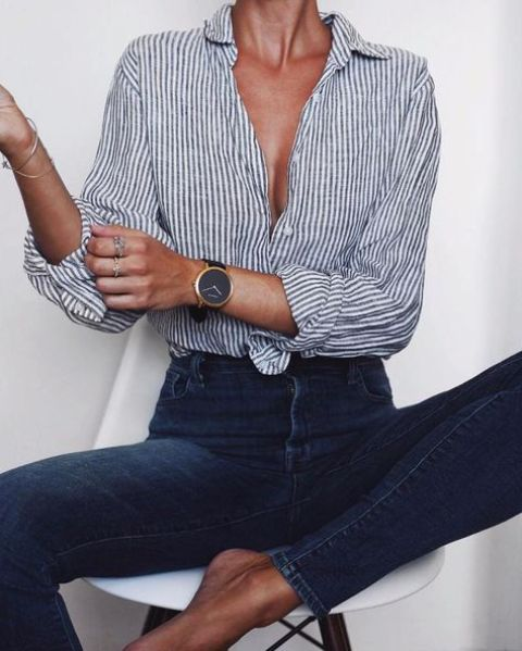 casual navy jeans, a striped button up shirt in grey and white