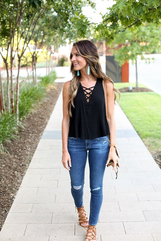 ripped denim, a black top and lace up sandals