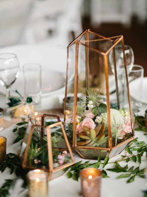 a terrarium centerpiece in mixed metallics (gold, rose gold, and silver) with small floral and succulents