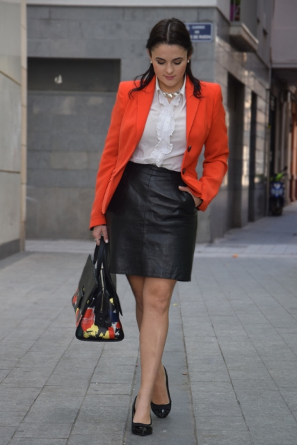 With white blouse, leather skirt and flats