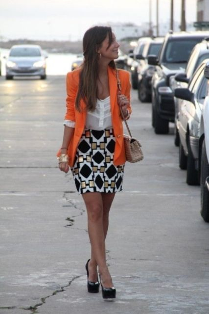 With white blouse, printed mini skirt and black shoes