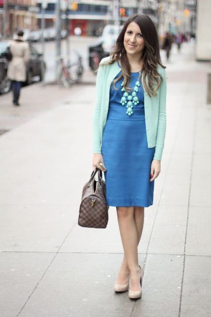 With blue dress and printed bag