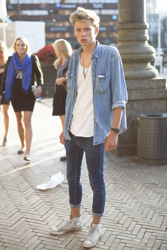 cuffed blue jeans, a white tee, a chambray shirt and grey Converse