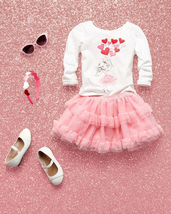 pink ruffled tulle skirt, a printed heart swetshirt and white shoes