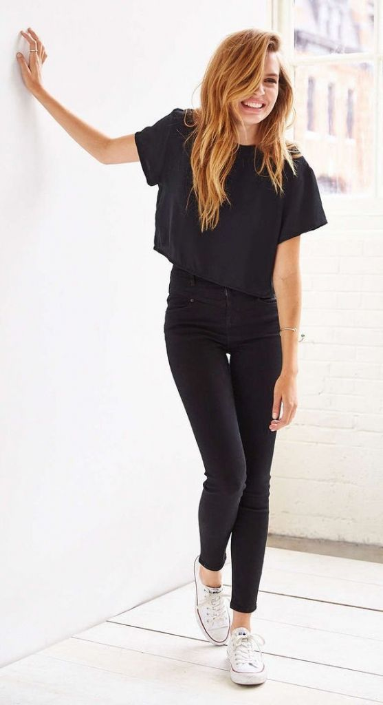 a black cropped tee, black jeans and white Converse