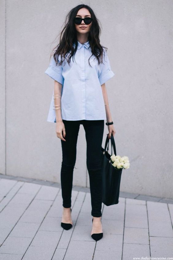 black jeans and heels, a light blue short-sleeve shirt