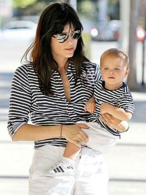 striped black and white tees and white pants for mom and her son