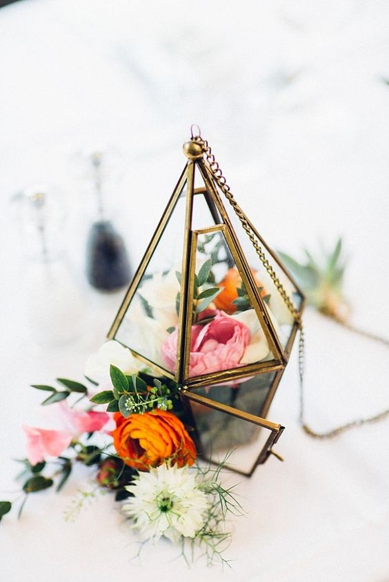 beautiful flower-filled terrarium with a chain to hang if you want
