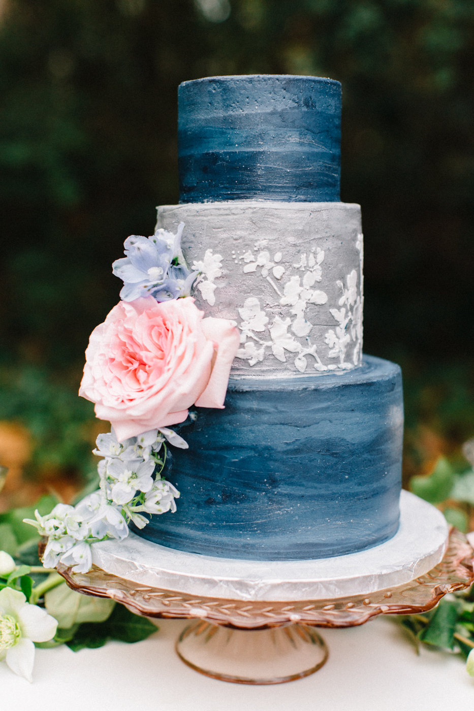 blue and grey wedding cake with flowers - photo by 4 Corners Photography http://ruffledblog.com/backyard-elopement-inspiration-for-valentines-day