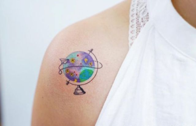 Colored tattoo on the shoulder
