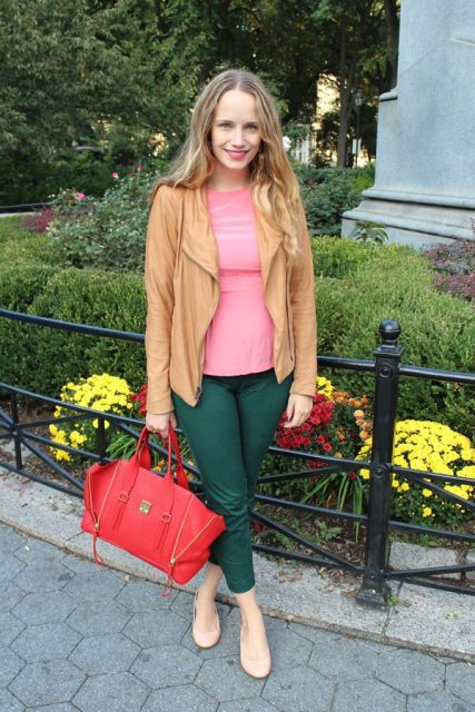With pink shirt, light brown jacket and red bag