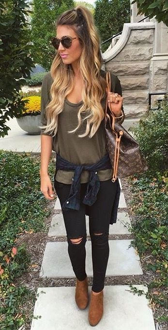 ripped black denim, an army t-shirt, brown booties