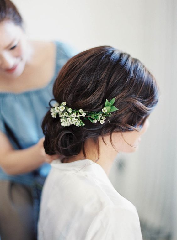 curly wedding hairstyle with lily of the valley