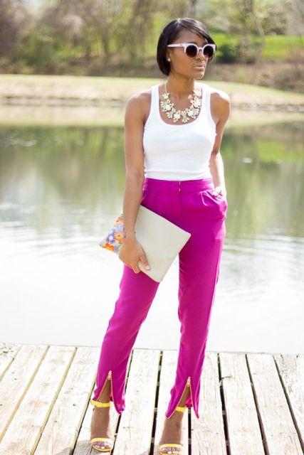 Fuchsia pants with white top, floral clutch and yellow heels are perfect if you want an eye-catchy work outfit.