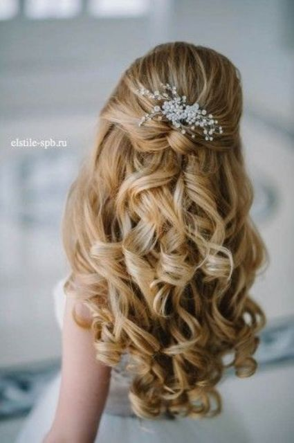 half up half down curly hairstyle with just some baby's breath