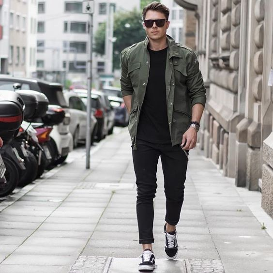 black jeans, a black tee, an army green jacket and black Vans