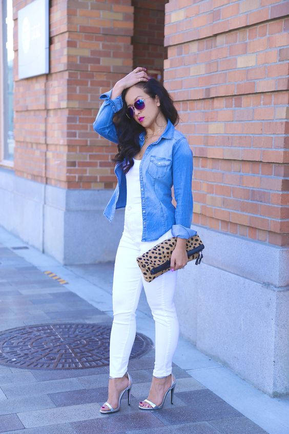 all-white look with a denim jacket and metallic heels