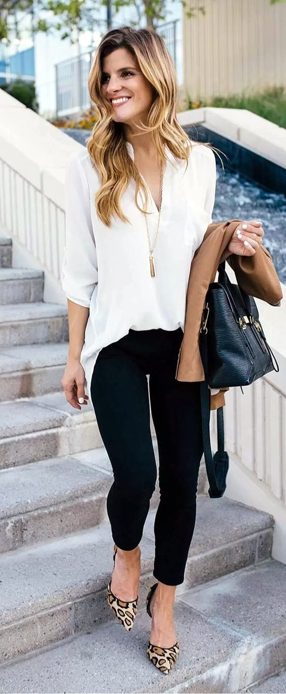 black jeans, a white shirt, leopard print heels and a tassel necklace