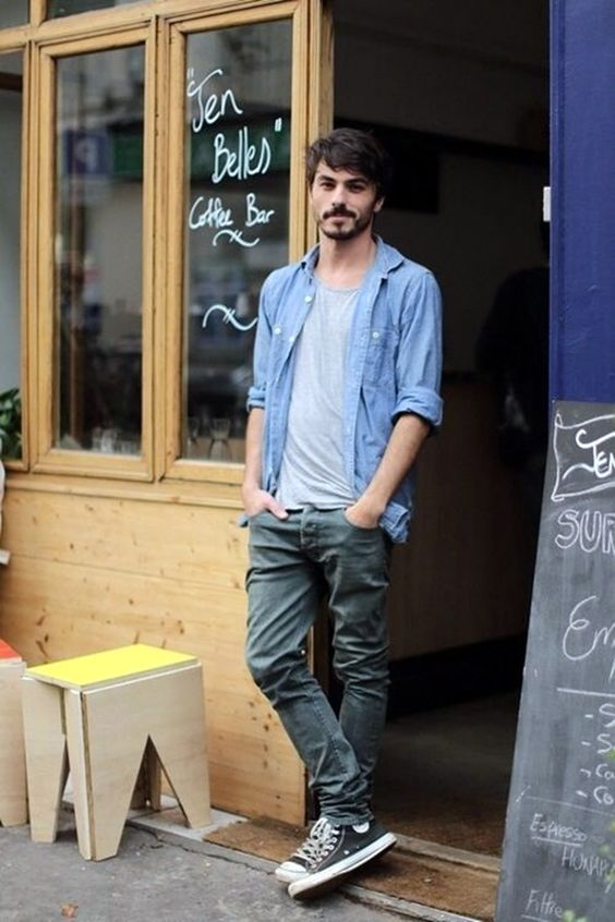green jeans, a grey tee, a chambray shirt and black Converse