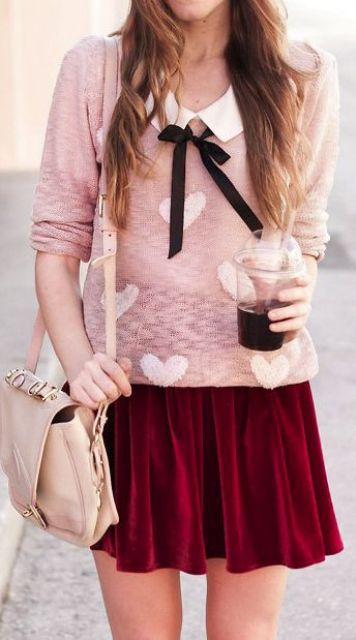pink heart-printed sweater with a collar and a burgundy mini skirt