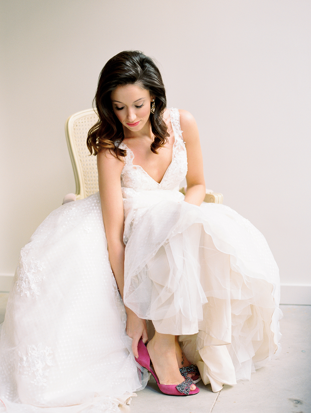 bride getting ready - photo by Erin Stubblefield http://ruffledblog.com/chic-city-valentines-day-wedding-inspiration